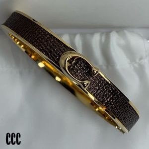 Coach Bronze Gold Open Closure Click C Bracelet